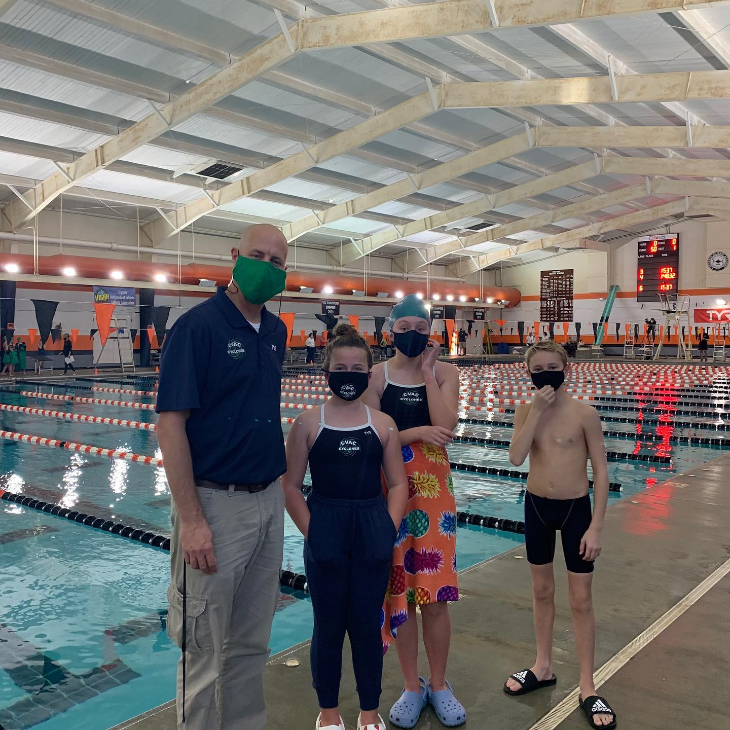 Coach and Age Group swimmers on deck